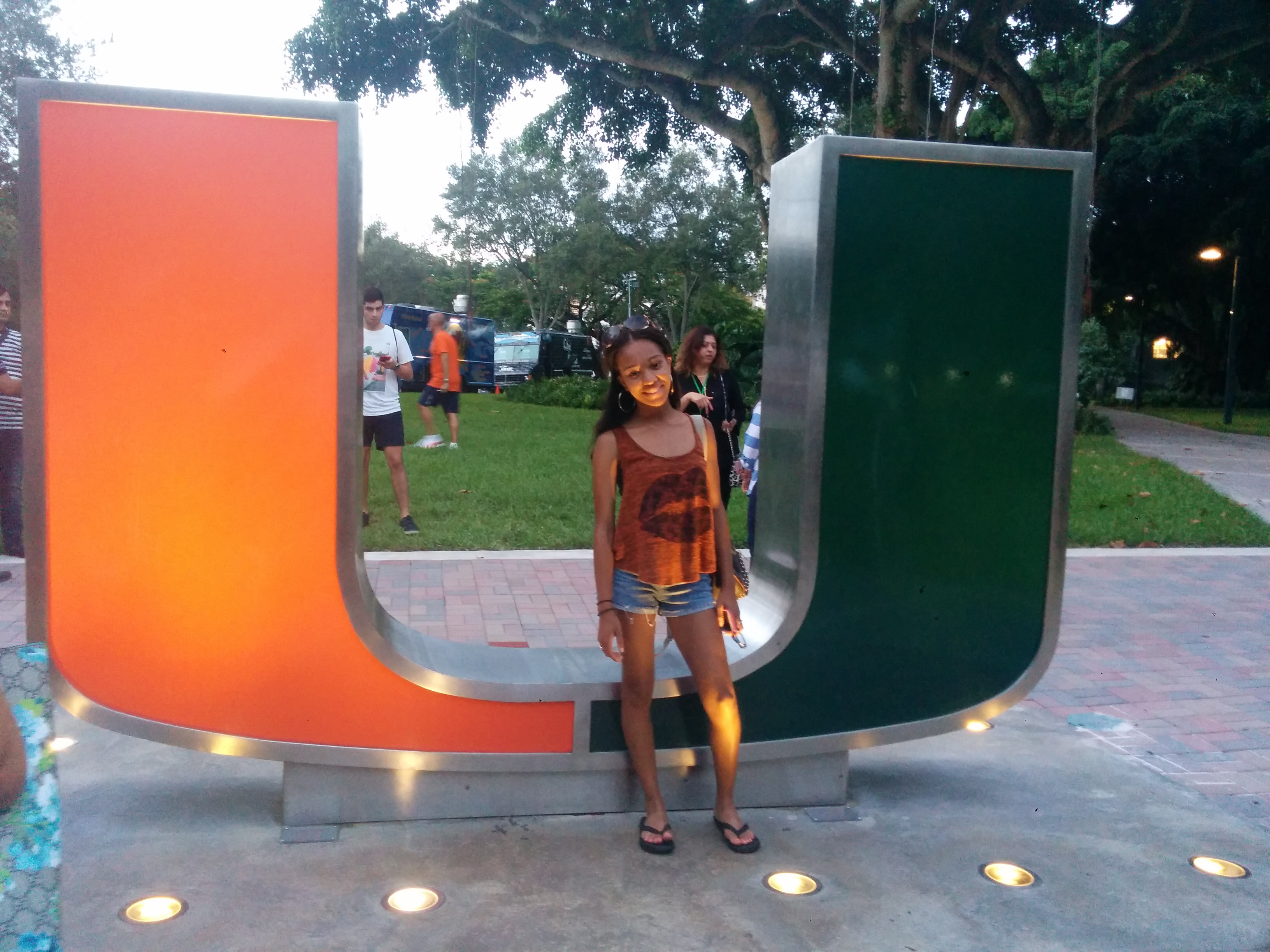 Milian in front of University of Miami logo